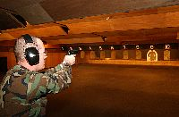 Damage Controlman 2nd Class Scott Johnson from Mt. Pleasant, Mich., practices with a 9mm pistol during training for base Military Police at the Commander, Fleet Activities Yokosuka indoor pistol & shotgun range