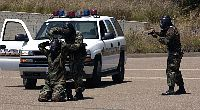 Sailors attending Commander Navy Region Southwest Training Center, arrest a suspect during a high-risk traffic stop training scenario.