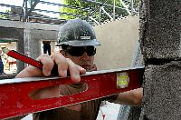 Builder 2nd Class Darby McCuller uses a level to draw an elevation line.