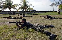 U.S. Marines assigned to a mobile training team instruct Guatemalan Marines on various tactical formations during small-unit tactics training.