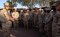 Adm. William J. Fallon, commander, U.S. Central Command, speaks with service members on board Camp Lemonier.