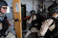 Visit, board, search, and seizure (VBSS) team members assigned to the guided-missile destroyer USS Chung-Hoon (DDG 93), breach a door during non-compliant boarding training.